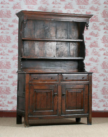A small early 18th Century oak canopy dresser, North Wales