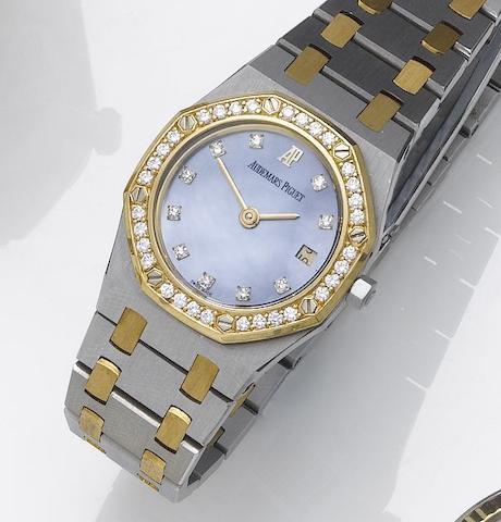 Audemars Piguet. A lady's stainless steel and gold, diamond set calendar bracelet watchRoyal Oak, 1990's