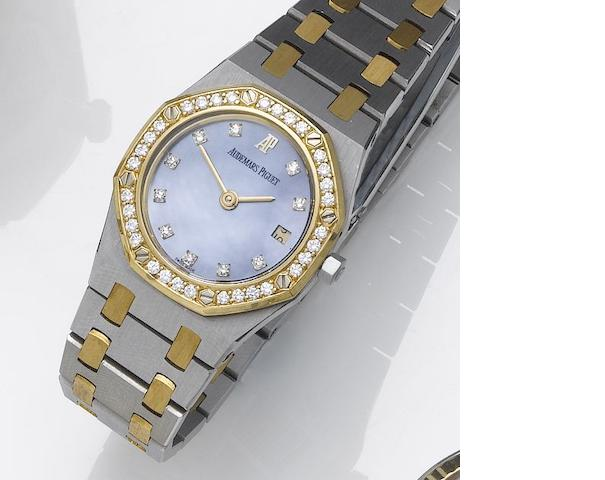 Audemars Piguet. A lady's stainless steel and gold, diamond set calendar bracelet watch Royal Oak, 1990's