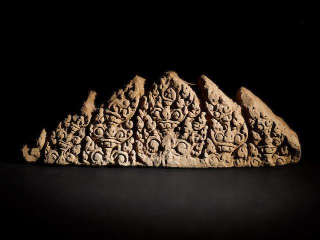A large Khmer sandstone relief fragment