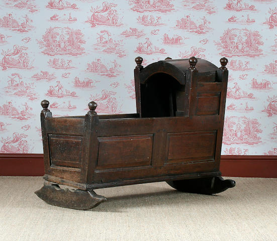 A mid 18th Century oak cradle
