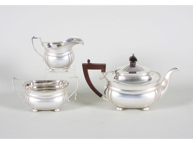 A silver three piece bachelor's tea set By Mappin and Webb, Birmingham, 1935,  (3)