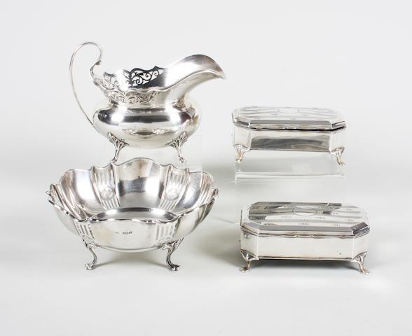 A silver cream jug Birmingham, 1923,  (4)