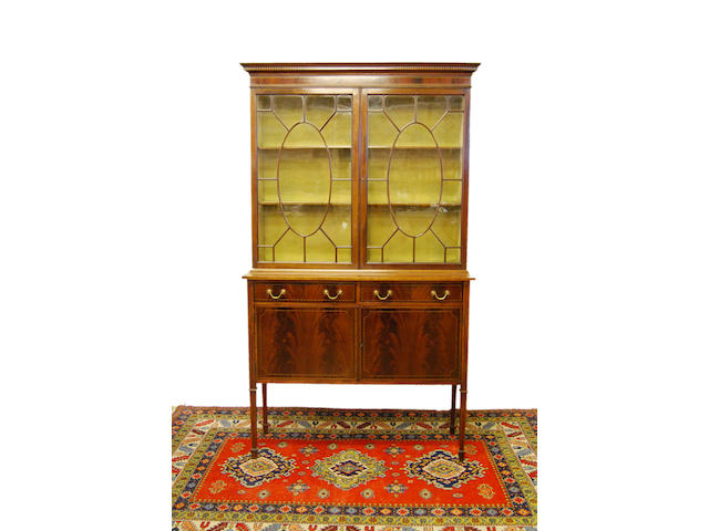 An Edwardian mahogany and inlaid display cupboard