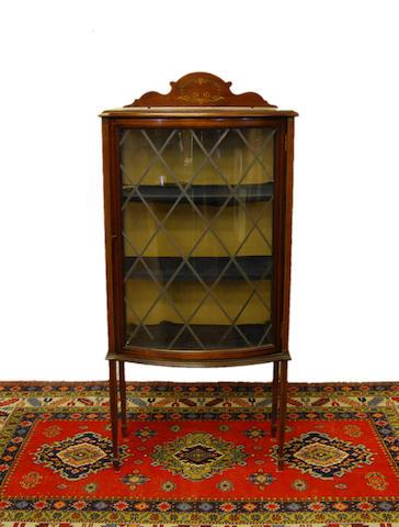 A small Edwardian mahogany bow-front display cabinet