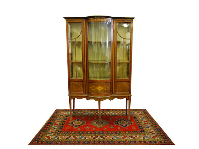 An Edwardian mahogany and inlaid bow-breakfront display cabinet