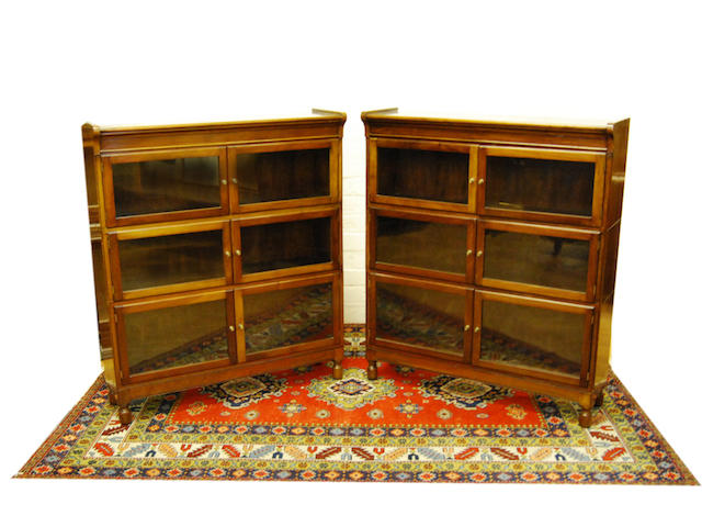 A pair of mahogany Globe Wernike-style mahogany bookcases, early 20th Century