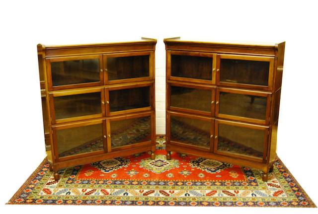 A pair of mahogany Globe Wernike-style mahogany bookcases, early 20th Century