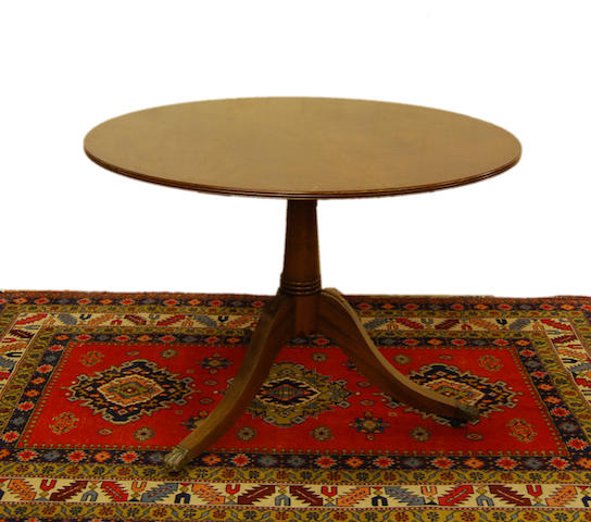 A mahogany and brass-strung tilt-top breakfast table