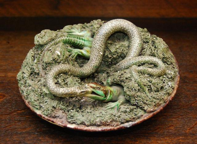 A Portuguese relief-moulded majolica dish
