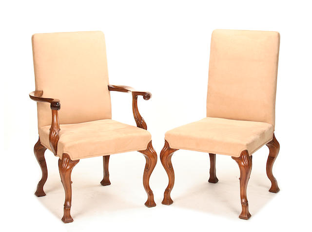 A set of sixteen George I style walnut dining chairs