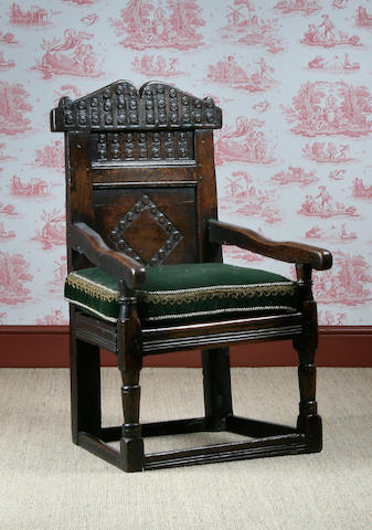 A late 17th Century oak child's wainscot chair