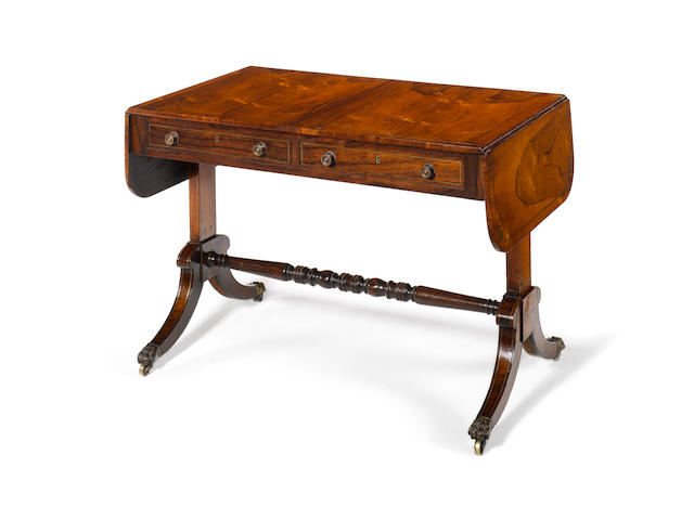 A Regency rosewood and brass inlaid Sofa Table