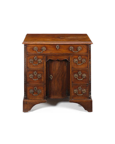 A George II carved mahagany Kneehole Desk