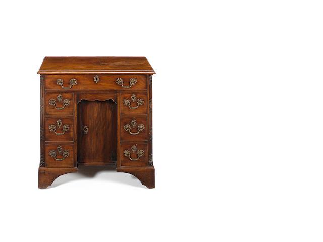 A George II carved mahagany Kneehole Desk