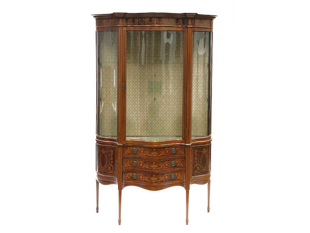 A pair of Edwardian mahogany and marquetry serpentine display cabinets