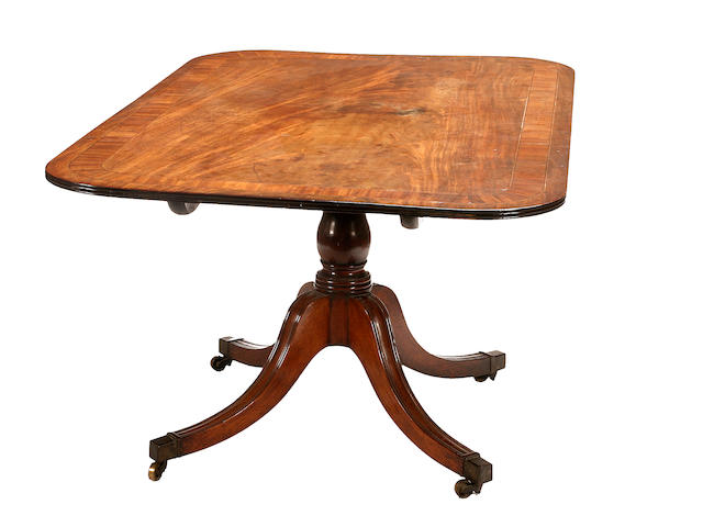 A late George III mahogany breakfast table