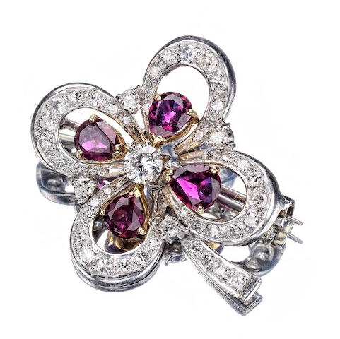 A ruby and diamond four leaf clover brooch, by Cartier