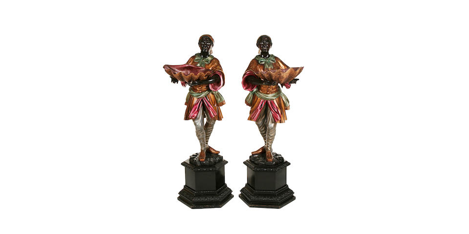 A pair of Venetian carved wood, gilded and polychrome decorated blackamoor figures