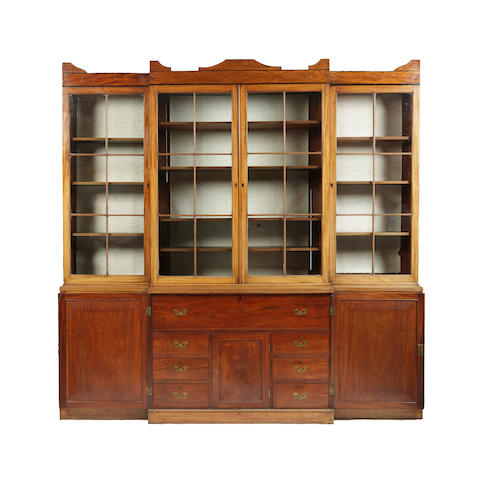 A Regency mahogany and ebony lined breakfront bookcase