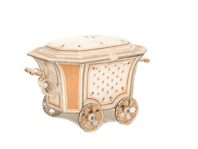 An early 20th century painted tole coal bucket in the form of a trolley