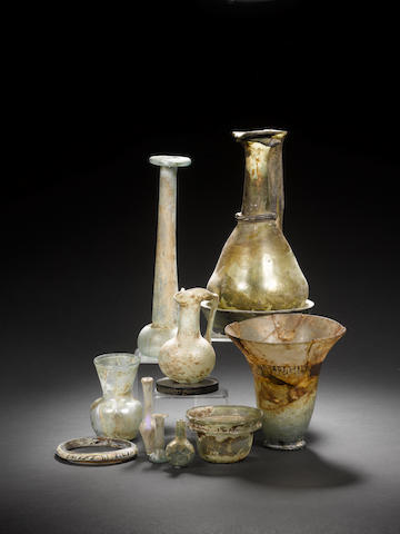 7 x small glass vessels, 1 x glass bracelet, 3 x books, a repaired Roman glass ewer, and an Islamic repaired vessel (12)