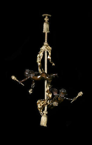 An Italian Baroque style patinated bronze and gilt brass figural ceiling light