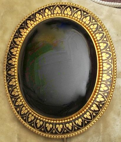 A Victorian onyx and enamel memorial brooch