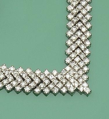 A diamond necklace and matching bracelet