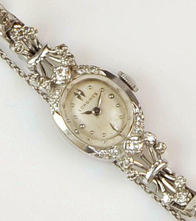 Longines: A diamond set lady's wristwatch