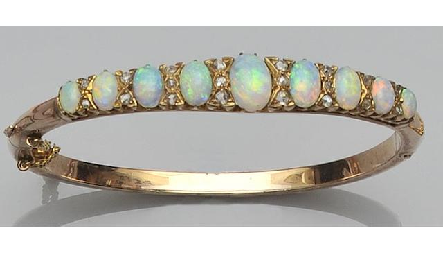 An opal and diamond hinged bangle