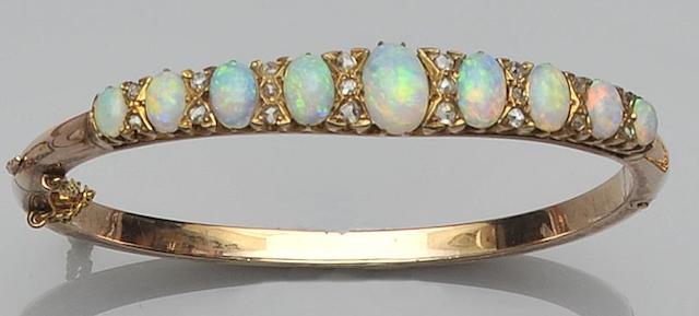 An opal and diamond hinged bangle