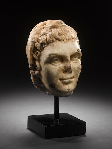 A Roman marble head of Hercules