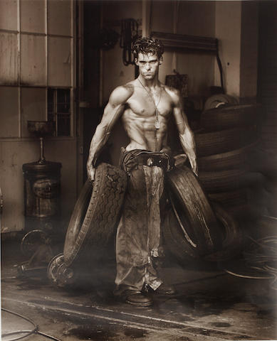 """Herb Ritts (American, 1952-2002) """"Fred with Tires"""" Body Shop Series 1984 signed, inscribed, dated and numbered 11/30 verso gelatin silver print 61 x 51cm. (unframed)"""