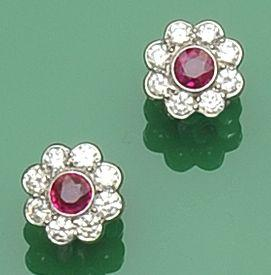 A pair of ruby and diamond flowerhead cluster earrings