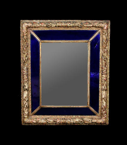A Venetian baroque style cobalt blue and clear glass mirror
