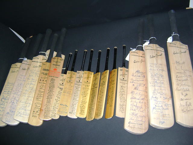 A collection of cricket bats with hand signed or printed signatures