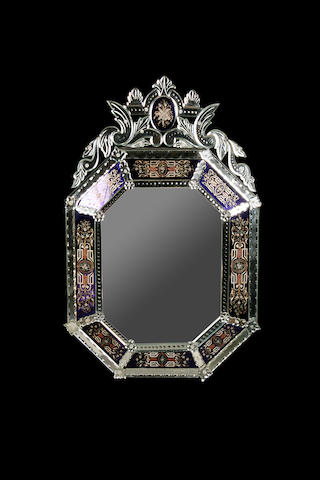 A Venetian style blue and clear glass mirror