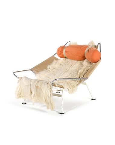 Hans Wegner for Getama a 'Flag Halyard' chair, designed 1950 painted tubular steel frame with flag halyard support and sheepskin throw
