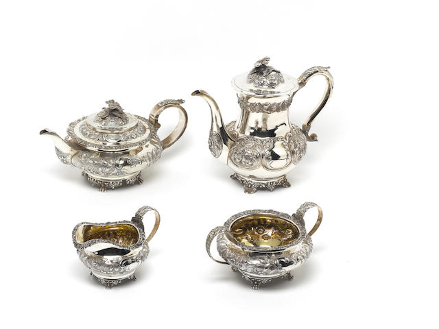 A George IV  silver three piece tea service, by Thomas Austin, London 1826, a coffeepot and a German salver. (5)