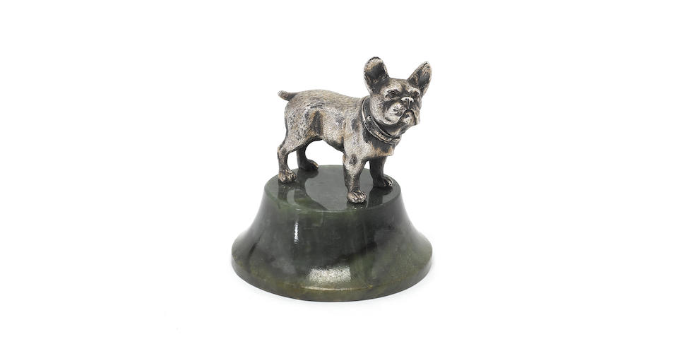 A late 19th/early 20th century silver and hardstone mounted model of a pug dog, indistinct mark, possibly a French control mark, retailed by Mappin & Webb,