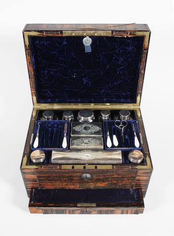 An early Victorian coromandel and brass inlaid and edged rectangular lady's dressing case by Wells of London