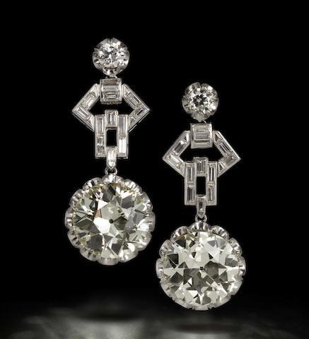An impressive pair of diamond pendent earrings,
