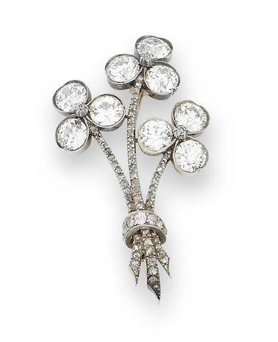 A diamond trefoil brooch,