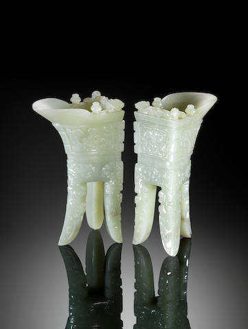 An important and rare pair of archaistic pale celadon jade wine vessels, jue Incised Qianlong four-c