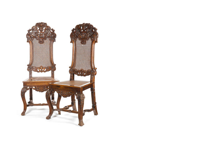 A pair of William & Mary carved walnut Side Chairs