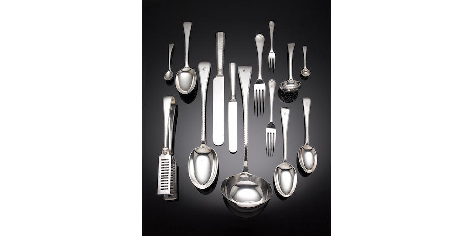 An extensive silver Old English Feather Edge table service of flatware, contained in a canteen box, by F. Higgins & Sons Ltd, London 1918 - 1920,