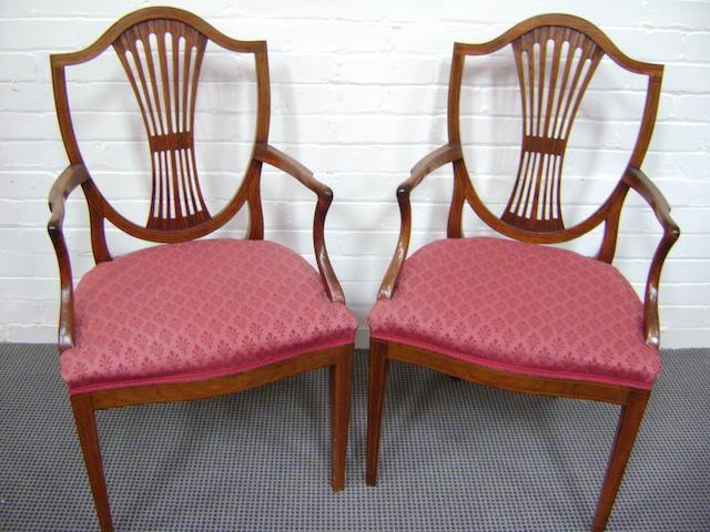 A set of twelve Edwardian mahogany dining chairs,