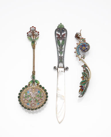 "A German silver, plique au jour and mother of pearl paperknife, by Theodore Müller, incuse stamped ""830S"" and five other pieces of plique au jour flatware. (6)"