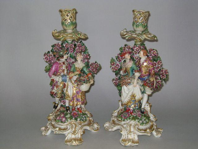 A pair of Chelsea candlestick figures Circa 1762-69.